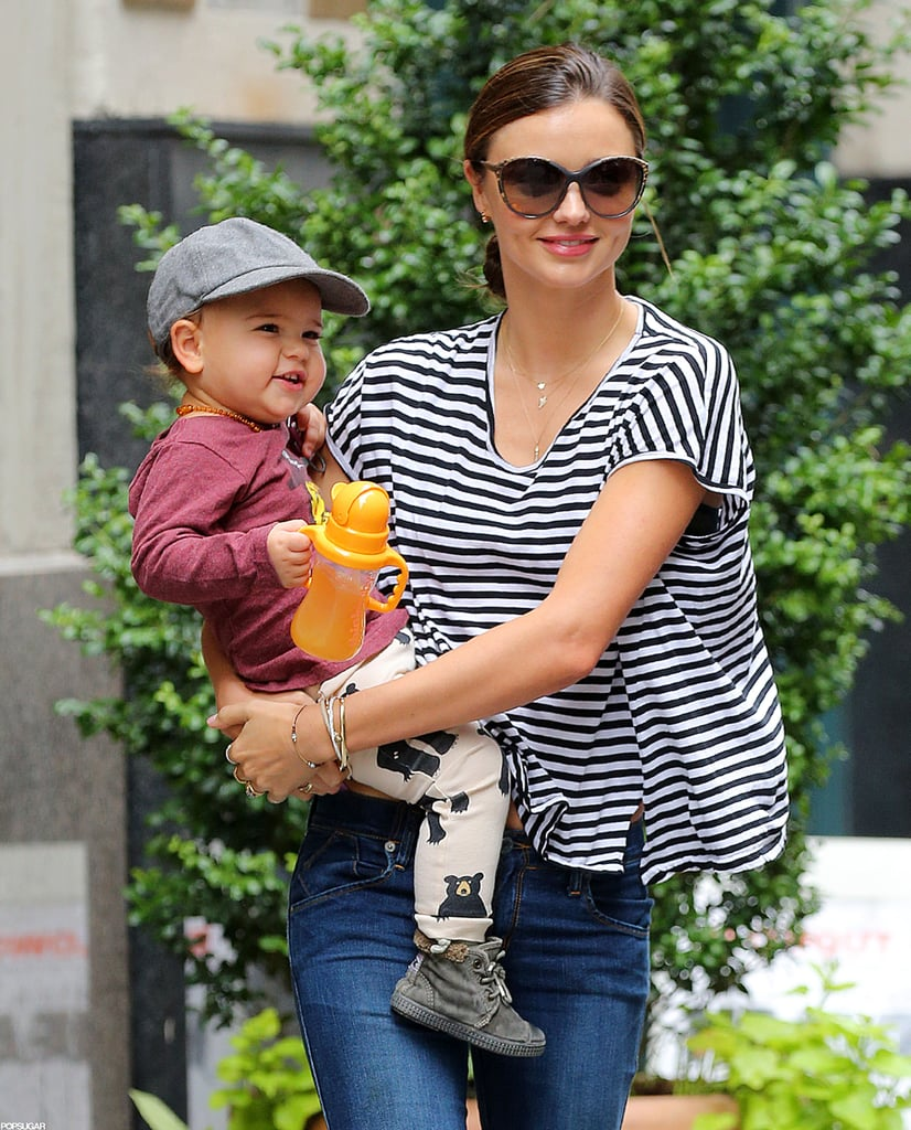 Miranda Kerr took a break from the parade of dresses she's been modeling recently and stepped out of her NYC hotel this morning in casual sneakers, jeans, and a striped t-shirt. Miranda and son Flynn Bloom have been hanging in the Big Apple in recent days while she's been busy modeling for various projects. Overseas, Orlando Bloom is also keeping himself occupied with promotional appearances on behalf of watch retailer Bremont. Work has put some space between Miranda and Orlando for now, but the family of three has had their fair share of fun this Summer, and they even took Flynn on a bikini-filled tropical getaway to Bora Bora.