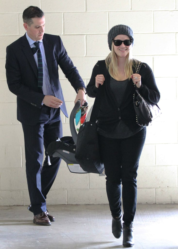 Reese Witherspoon coordinated her gray ribbed beanie with her gray-and-black ensemble: a gray tee, black cardigan, black jeans, Rag & Bone booties, and a studded Valentino bag.