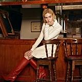 Elle Fanning wearing a Longchamp dress and Salvatore Ferragamo boots.