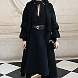 Cloaked in all black, Olivia brought a polished, more dramatic look to the Christian Dior show.