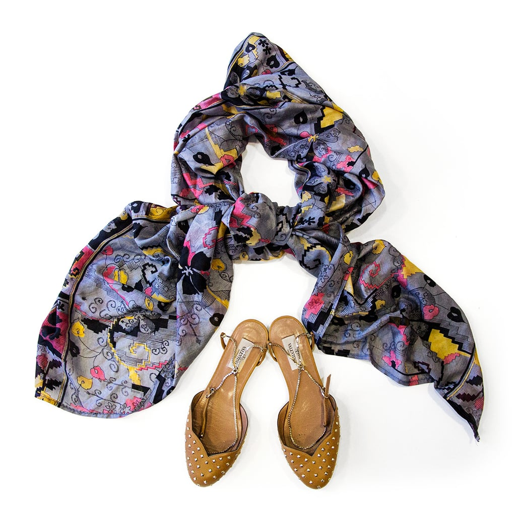 I bought this silk scarf in Paris for 10 Euros and I rarely leave home without it. It's warm but light-weight, and packs up real small. Flats are my handbag essential: be they my trusty Havis, a pair of foldable ballets or these slightly more luxe Valentino beauties.