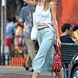 Rosie beat the heat in NYC with a breezy skirt.