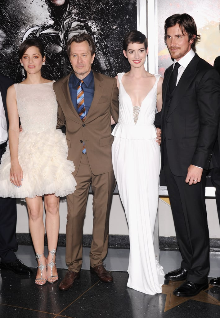 The Dark Knight Rises cast made an entrance at their big premiere in NYC last night. Leading ladies Anne Hathaway and Marion Cotillard both looked glamorous in white, with Anne wearing a Prabal Gurung gown, with Kwiat jewels, and Marion in a short Christian Dior dress. Their costar Christian Bale was dapper in a suit and vest as he posed with wife Sibi on their way into the event. Joseph-Gordon Levitt, Morgan Freeman, and Gary Oldman were also on hand, as was actress Juno Temple. Gossip Girl's Leighton Meester showed up for the screening but skipped the carpet, while her small-screen costars Michelle Trachtenberg and Penn Badgley both stopped for cameras.  Anne has been on the go promoting her Summer blockbuster ahead of its release this Friday, and to get you ready, we're taking a look back at all The Dark Knight Rises pictures. Anne has made time for her fiancé, Adam Shulman, though, and the duo were spotted showing PDA in Manhattan just last week.