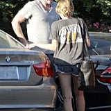 Miley and Liam chatted by the car.