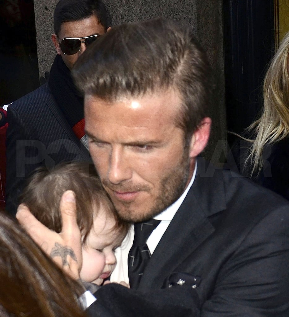 David Beckham held his adorable daughter.