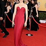 Julianna Margulies looked totally sophisticated and sexy in a red YSL column dress.
