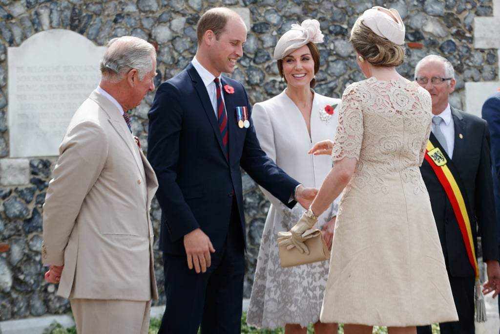 After touring Poland and Germany with their family in early July, Prince William and Kate Middleton continued their royal duties by heading to Belgium on Monday to attend a ceremony marking the centenary of the Battle of Passchendaele. While Will donned a blue suit for the occasion, Kate recycled her Alexander McQueen dress, which she wore to Princess Charlotte's christening back in 2015. Aside from meeting with soldiers at the Commonwealth War Graves Commisions's Tyne Cot Cemetery, the prince also spoke during the Last Post ceremony, which has been performed at the site every night since 1928. Following their outing, Kate and Will sneaked in a little PDA as he sweetly touched her back as they made their way to their car.