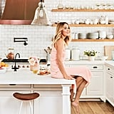 Lauren admits she's messy when she cooks, which is why she opted for Mystery White marble countertops, which are more stain resistant than Carrera. White subway tile and open shelving complete the contemporary boho-chic look.