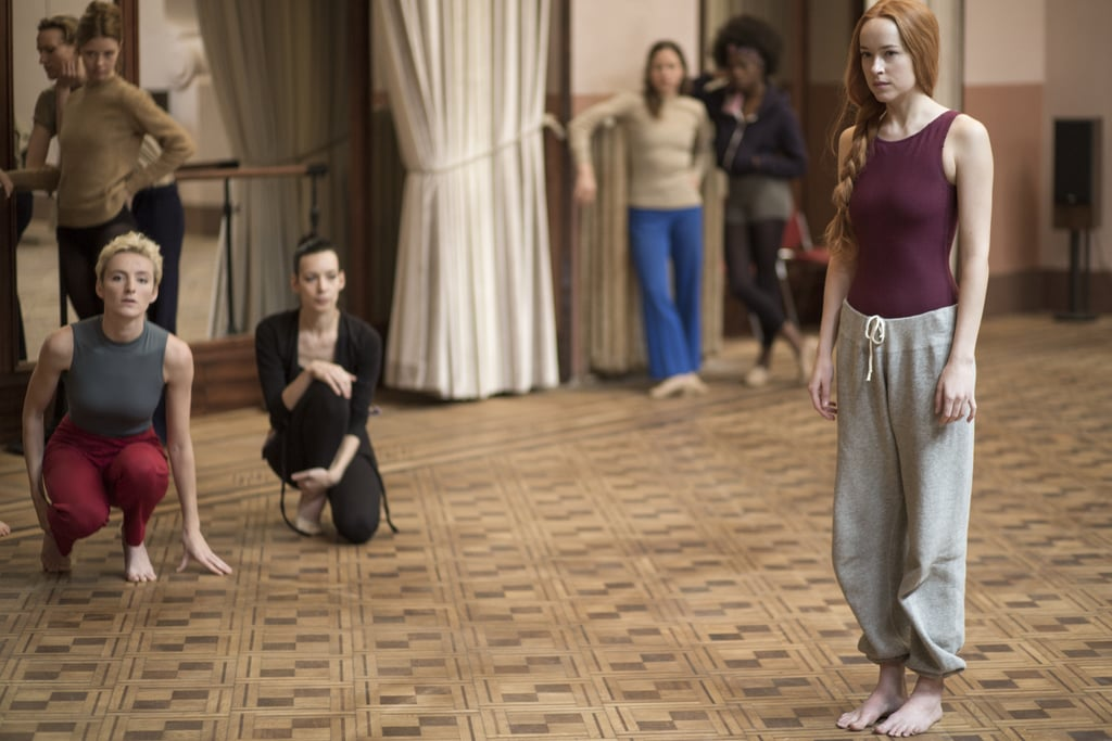 "Suspiria is still a few months away from arriving in theaters, but we've already gotten two exciting nuggets of information about the horror film straight from director Luca Guadagnino: there's definitely a postcredits scene, and there might be two sequels. Scary movie-lovers, we are blessed. The Call Me by Your Name director recently sat down with Deadline to discuss the film starring Dakota Johnson and Tilda Swinton, a remake of the 1977 movie of the same name. He noted that they were going to title it Suspiria: Part One at first because the original Suspiria, directed by Dario Argento, was actually part of ""The Three Mothers"" trilogy, which also includes 1980's Inferno and 2007's The Mother of Tears. Ultimately, Guadagnino decided against tying the title of the film to the trilogy.      Related:                                                                                                           Yes, Suspiria's New Trailer Will Give You Nightmares               ""At the beginning we were going to title the movie Suspiria: Part One but we didn't want to give the impression of something that couldn't stand alone,"" he said. ""Truthfully, I'd be interested to explore the origin of Madame Blanc and Helena Markos and also the future of Suzy Bannion in the world. So maybe. We'll have to see how the movie goes."" In addition to diving into the backstory of Tilda Swinton's Madame Blanc (the leader of a world-renown dance company and a deadly coven) and Helena Markos (a powerful witch from the Three Mothers trilogy), the director confirmed that there's a scene worth sticking around past the credits for. When Deadline asked him what ""the message"" was behind the final shot, Guadagnino said that the character featured in the scene is ""is looking forward towards something. I think it would be interesting to know what that is . . ."" Suspiria doesn't come out until Oct. 26, but until then, take a look at all the chilling photos from the film that have been released thus far, ahead."
