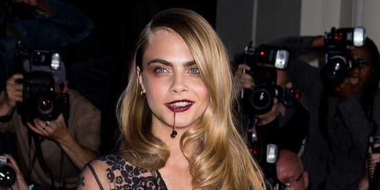 Cara Delevingne Makes Falling Look Cool At The GQ Man Of The Year Awards