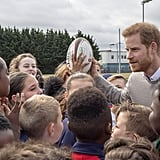 Prince Harry Hugs Kids at Lealands High School