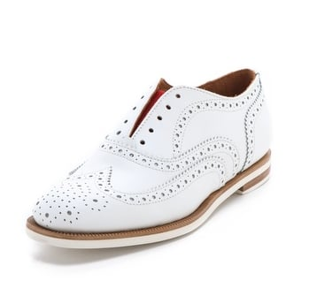 For the gal who's willing to do a little splurging, look no further than these Rag & Bone white brogue oxfords ($347, originally $495).