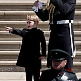 Prince William with George at Prince Harry's wedding.