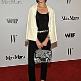 Lauren Remington Platt was the picture of sophistication in a Max Mara silky ivory blazer and silk jersey skinny trousers, with a printed bag in hand for added oomph.