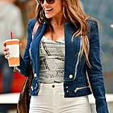 Jennifer Lopez in Newspaper Top and White Jeans on Set 2019
