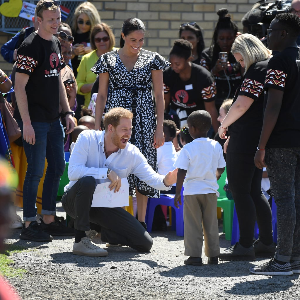 "And they're off! On Monday, Prince Harry and Meghan Markle kicked off their royal tour of Southern Africa. The couple's 4-month-old son, Archie Mountbatten-Windsor, has made the trip with his parents, but Harry and Meghan stepped out without him as they made their first appearance, visiting a workshop that teaches children about their rights, self-awareness and safety. The Duchess of Sussex stunned, as per usual, in a black and white printed wrap dress, while Harry kept things casual in a button-down and black pants. The goal of this tour is to bring awareness to causes that are important to Harry and Meghan, as well as Harry's late mother, Princess Diana. The trip will extend until Oct. 2 and will include stops in South Africa, Botswana, Angola, and Malawi. However, Archie will reportedly ""only be present on certain safer parts of the trip"" and will remain with his nanny most of the time.  In 2018, the Duke of Sussex made a handful of significant trips to Africa on behalf of his Sentebale charity and to raise awareness on the importance of education for young girls. He and Meghan also embarked on a tour of Morocco, where they learned about the country's efforts to further education equality. Clearly, the Sussexes are determined to make a positive impact in the world. See all the photos from their royal tour ahead!      Related:                                                                                                           All the Ways Prince Harry Is Following in Diana's Footsteps"