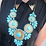 From the gold-capped collar to a turquoise statement necklace, this look was definitely a head-turner — even in the wildest of crowds.