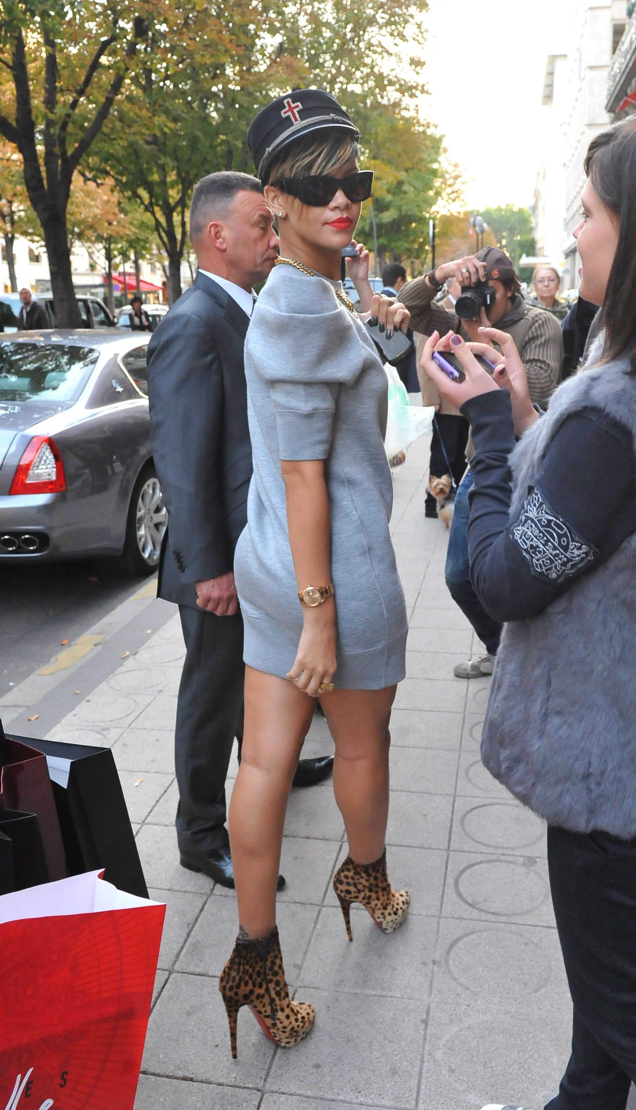 38c04df119c0 Photos of Rihanna in Paris in Animal Print Christian Louboutin Boots ...