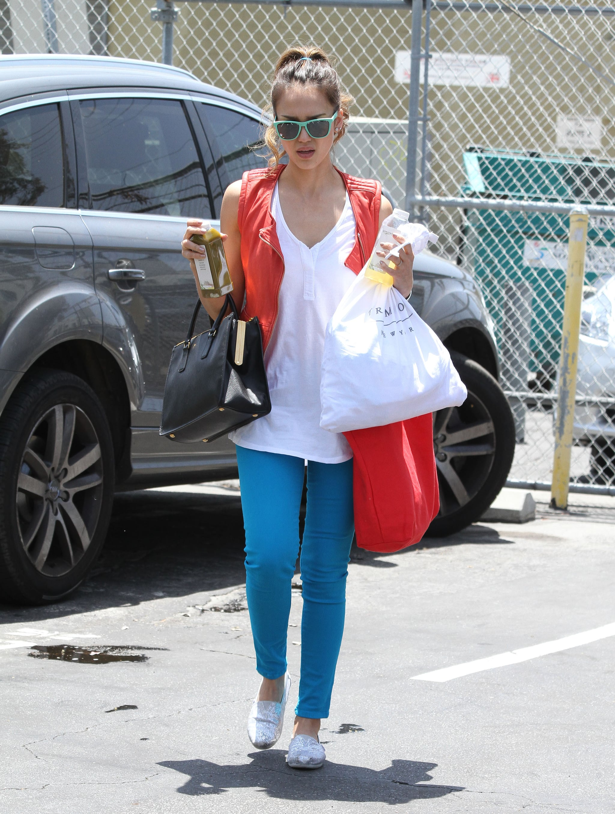 Jessica showcased a patriotic pairing with a twist, in a red leather vest, turquoise denim, sparkling TOMS, and a polished Prada tote in LA.