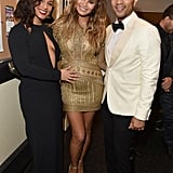 Chrissy shimmered in a gold minidress while posing with husband John Legend at a concert in Las Vegas.