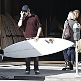 Liam Hemsworth bought a new surfboard with Miley Cyrus in LA.