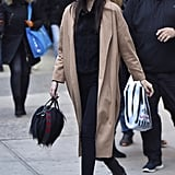 Kendall Jenner kept a low profile with a baseball cap and duster coat in NYC.