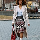 A neutral trench is a must have as it goes with everything. Take a fashion tip from Elaine Welteroth and amp up your simple coat with printed pieces like a skirt or top.