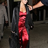 Leaving the Airport Wearing a Red Jumpsuit and Tiny Sunglasses