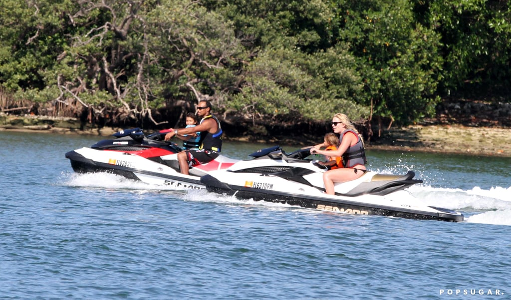 Lindsey Vonn and Tiger Woods hopped on water skis to take his kids, Sam and Charlie, for a ride in Palm Beach, FL.