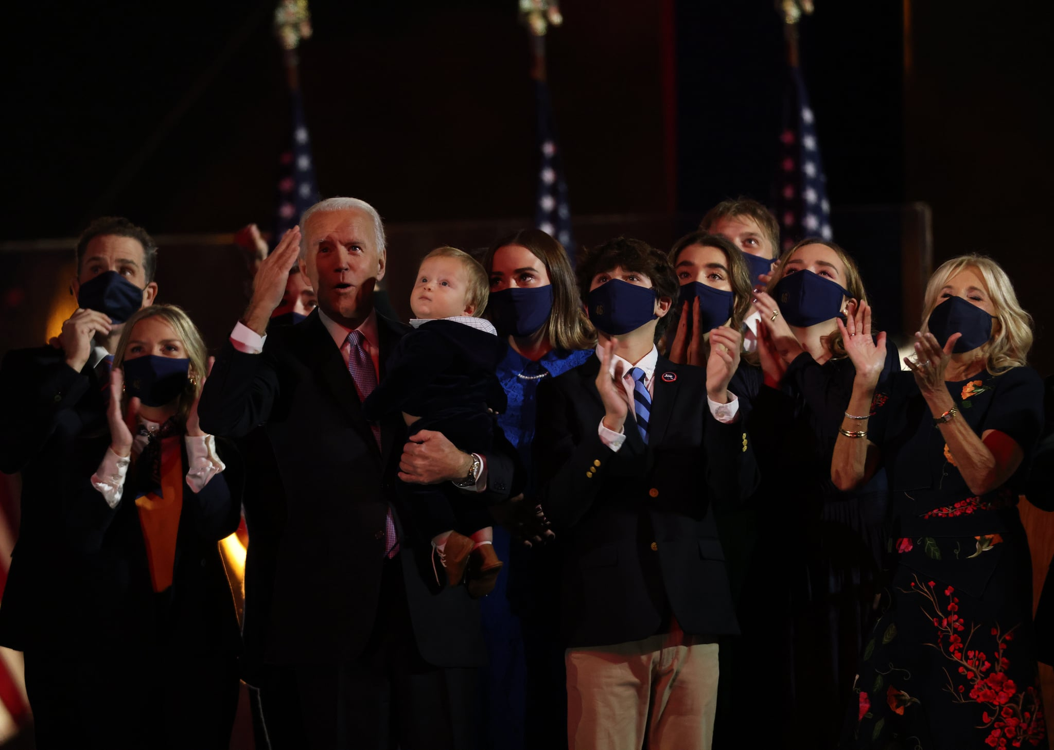 WILMINGTON, DELAWARE - NOVEMBER 07:  President-elect Joe Biden and family watch fireworks from stage after Biden's address to the nation from the Chase Center November 07, 2020 in Wilmington, Delaware. After four days of counting the high volume of mail-in ballots in key battleground states due to the coronavirus pandemic, the race was called for Biden after a contentious election battle against incumbent Republican President Donald Trump. (Photo by Win McNamee/Getty Images)