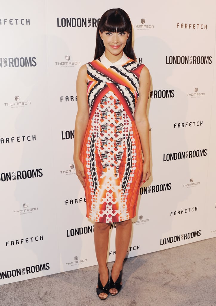 New Girl star Hannah Simone looked prim and sophisticated in this orange-toned Peter Pilotto dress for a British Fashion Council event in April.