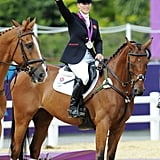 Zara Phillips, the queen's granddaughter, raised her flowers after winning the silver medal.