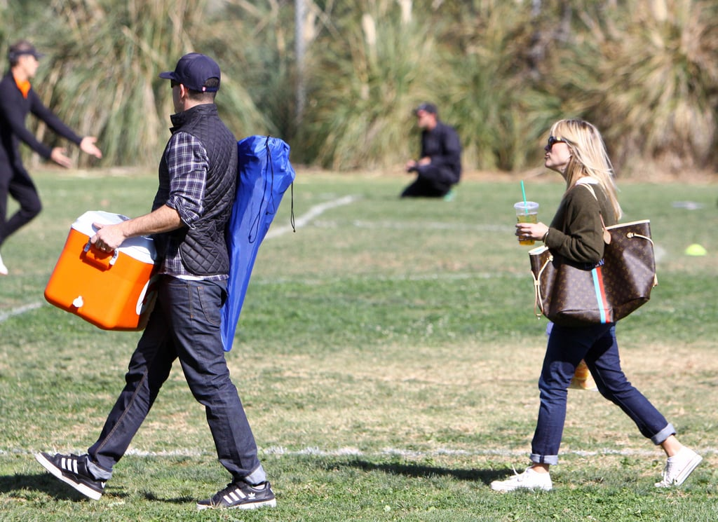 Jim Toth and Reese Witherspoon arrived at the soccer field.