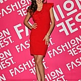 Miranda Kerr posed in fiery red dress, complete with dainty ruffle details, and patent t-strap sandals at the Liverpool Fashion Fest in England.
