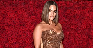 Ashley Graham Is a Golden Angel, but the Slit in Her Dress Is Showing Her Sexy Side