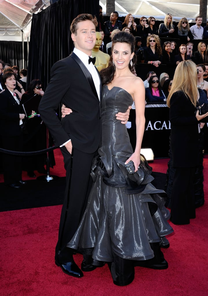 Armie Hammer and his wife, Elizabeth Chambers, coordinated for the red carpet at this evening's Oscars. The hot star of The Social Network is out promoting the best picture nominee film — which of the 10 pictures up for the honor do you think will win? Armie has been busy lately shooting J. Edgar alongside Leonardo DiCaprio, but he looked happy to have a break from the set for a fancy night out with Elizabeth. Make sure to see lots of action from the show on our livestream from the carpet!
