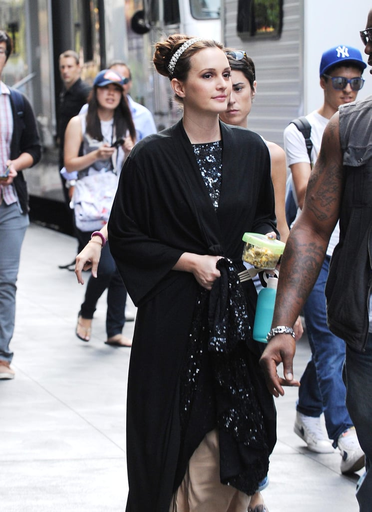 Leighton Meester stepped out of her trailer wearing a black robe on the set of Gossip Girl in NYC.