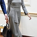 ‎Meghan Markle Carrying a Fendi Peekaboo Essential Leather Handbag in Black and Beige