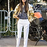 A metallic jacket is unexpected with a nautical stripe and white pants.