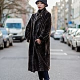Style Your Leopard-Print Coat With: A Bucket Hat and Sneakers