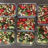 Whole-grain pasta salad with tomatoes, cucumbers, broccoli, and peppers.