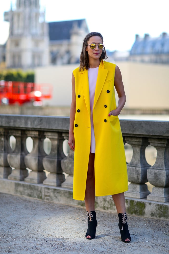 How cool is this bright yellow, sleeveless Dior coat?