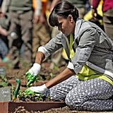 Even when she's gardening, Michelle Obama looks great. For the fifth annual White House Garden Kitchen event, the FLOTUS paired a citron-hued top with printed denim and low-top Converse.