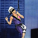"2009: During the show, she flew through the air (while blindfolded!) to perform ""Sober."""