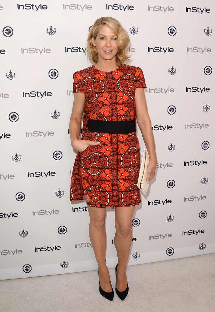 Jenna Elfman donned a bright orange dress at InStyle's Summer party.