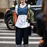 If you're going to wear oversize clothes, commit to it right down to the jeans. This street style star kept her bottoms a little baggy to create a menswear-inspired outfit.