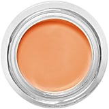 Use a salmon-colored concealer