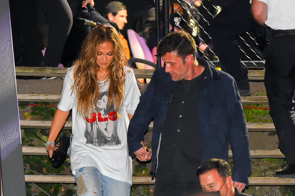 """Jennifer Lopez and Ben Affleck have not-so-subtly confirmed that they can't keep their hands off of each other, but their most recent PDA moment has us sighing like we're watching an IRL rom-com. On 25 Sept., the cuddly couple attended the Global Citizen Live festival in New York City. After performing a set in Central Park — including """"If You Had My Love"""", """"Love Don't Cost a Thing"""", """"I'm Real"""", and """"Ain't It Funny"""", and a new song called """"On My Way"""" from her upcoming film Marry Me — Jennifer left the event hand-in-hand with Ben. Sticking with the concert theme, Jennifer kept her date-night look casual, throwing a glittery J Lo T-shirt with side cut-outs over a pair of ripped jeans cuffed at the ankles with silver stilettos. As they cozied up together outside of the venue, Ben took a moment to help Jennifer down the stairs in her stylish but potentially hazardous heels. Maybe it's just the mental image of Ben and Jennifer strolling through Central Park as the orange and yellow autumn leaves trickle down around them, but the simple moment was adorably romantic. Take a peek at Jennifer and Ben's sweet date-nigh photos here.       Related:                                                                                                           See J Lo and Ben Affleck's Recent Red Carpet Debut Side by Side With Their Original One"""