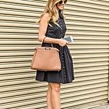 A figure-flattering day dress