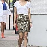 Keri paired her leopard-print Saint Laurent number with a loose, slouchy scoop neck, so she's comfortable up top (regardless of what she's got going on below). With a striking, form-flattering skirt; major heels; and simple accessorizing, you can bank on a serious confidence boost.  Source: Bauer-Griffin / Simon Earl
